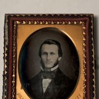 Daguerreotype of man with large square bowtie  stamped Pollack Balto 1.jpg