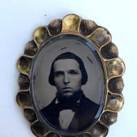 Rose Gold Scalloped Edge Broach with Tintype Portrait of Young man with Beard 1.jpg
