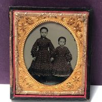 Circa 1870s Ambrotype of Two Sisters Dressed Exactly The Same 1.jpg